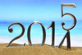 stock photo of new year 2014  - New year 2015 is coming on the beach - JPG