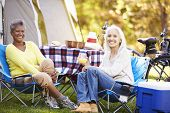 Two Mature Women Relaxing On Camping Holiday