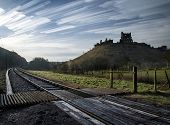 pic of unique landscape  - Unique time lapse stack landscape of medieval castle and railway tracks - JPG