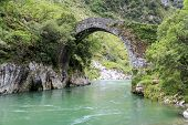 foto of old bridge  - Old Roman stone bridge in Asturias Spain - JPG