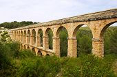 picture of aqueduct  - Beautiful view of roman Aqueduct Pont del Diable in Tarragona - JPG