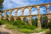 stock photo of aqueduct  - Beautiful view of roman Aqueduct Pont del Diable in Tarragona - JPG