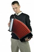 stock photo of accordion  - young man playing accordion on white background - JPG
