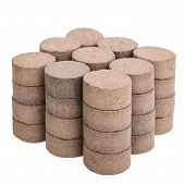 foto of briquette  - Peat briquettes for growing seedlings isolated on white with clipping paths - JPG
