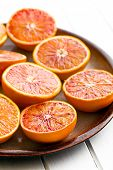 foto of orange peel  - halves of  red oranges on plate - JPG