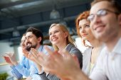 stock photo of applause  - Photo of happy business partners applauding at conference - JPG