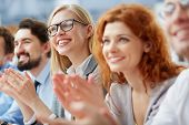 picture of applause  - Photo of happy business people applauding at conference - JPG