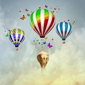 Elephant flying in sky on colorful aerostat