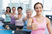 pic of senior class  - Portrait of smiling women gesturing thumbs up in the yoga class - JPG