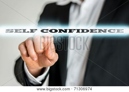 Businessman Activating A Self Confidence Button On Virtual Screen.jpg