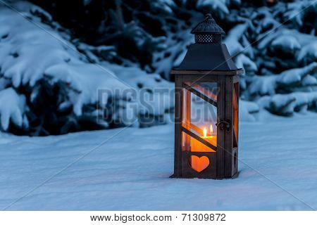Picture%20or%20Photo%20of%20A%20lantern%20lights%20up%20in%20the%20snow%20at%20christmas.%20romantic%20light%20on%20one%20evening%20in%20the%20winter.%20peace%20and%20quiet