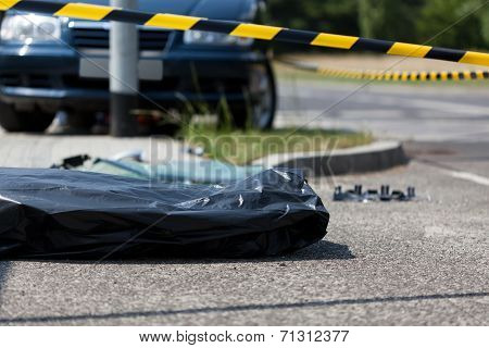 Corpse In Plastic Bag After Car Accident