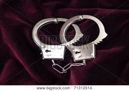 Closeup shot of metallic handcuffs