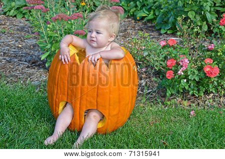 little girl in Halloween pumpkin