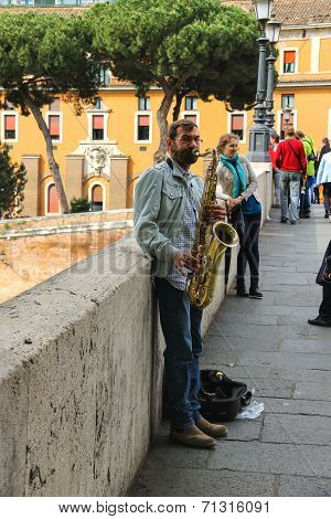 Street Musician Playing The Saxophone In Rome, Italy