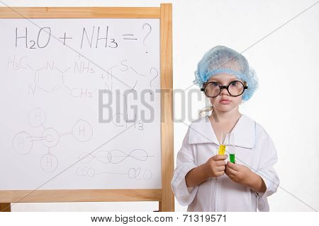 Chemist Girl In Points And With The Tubes At Board
