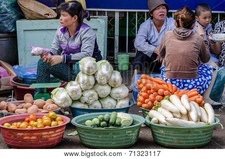 woman sell fresh vegetable at street market