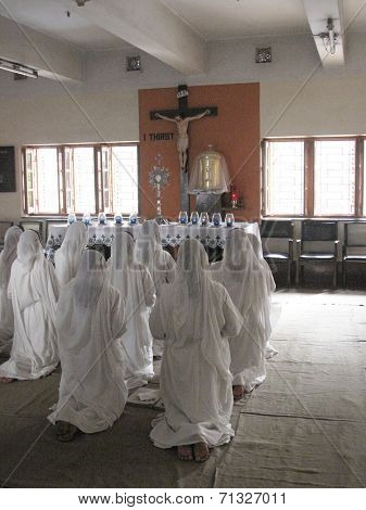 KOLKATA, INDIA - JANUARY 27: Sisters of Mother Teresa's Missionaries of Charity in prayer in the chapel of the Mother House, Kolkata, India at January 27, 2009