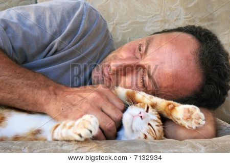 Relaxing Man And Cat