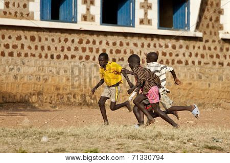 TORIT, SOUTH SUDAN-FEBRUARY 20 2013: Unidentified boys play soccer in the town of Torit, South Sudan