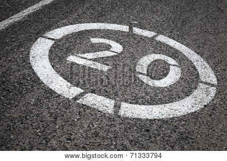 Speed Limit Road Sign On Gray Asphalt