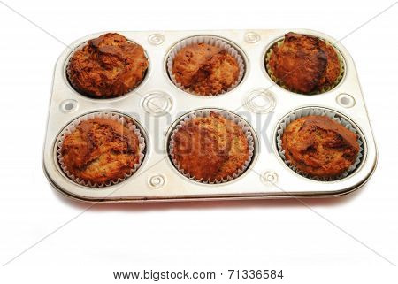 Homemade Banana Muffins Cooling In A Baking Tin