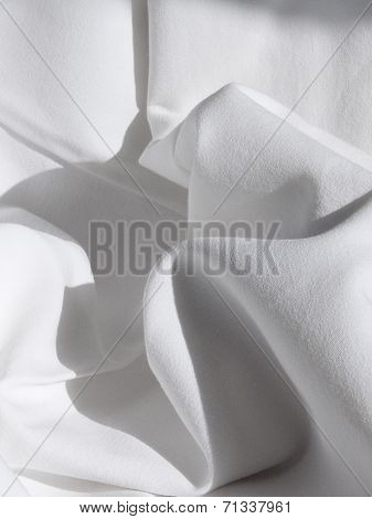 Cloth drape with folds - Closeup of a beautiful white rippled bed sheet