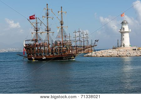 Tourists enjoying sea journey on vintage sailships in Alanya Turkey.