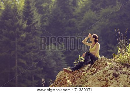 Tourist Woman Resting On Rock