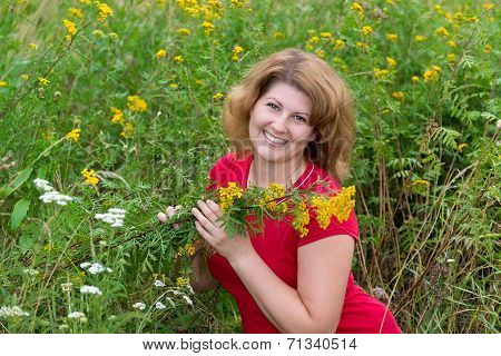 Middle-aged Woman On A Meadow With Tansy