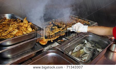 Chef Grilling Meat At Barbecue Dinner Buffet