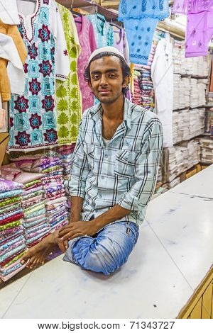 Small Shop Owner Indian Man Selling Shawls And Clothing At His Store