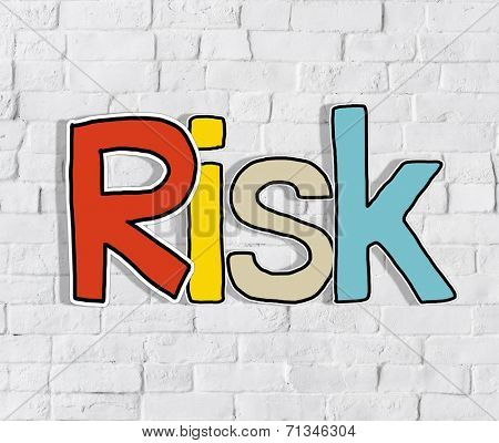 The Word Risk on a Brick Wall Background