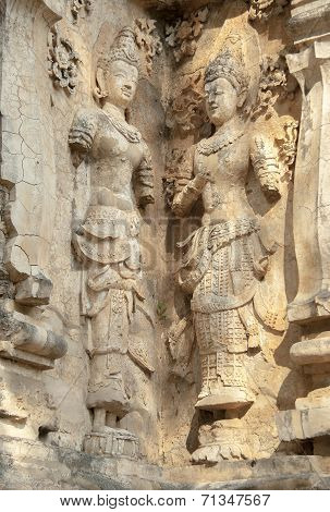 decorated wall with a mythological figure