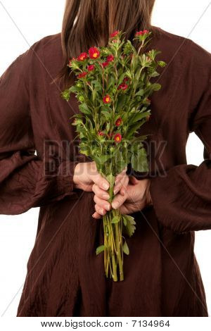 Woman Holding Flowers Behind Her Back