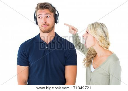 Young couple having an argument on white background