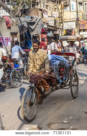 Cycle Rickshaws With Passenger In The Streets