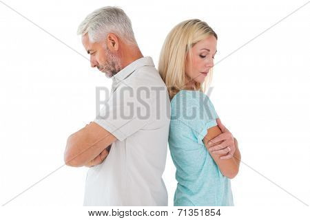 Unhappy couple not speaking to each other on white background