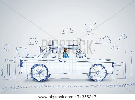 Young woman driving car made of paper