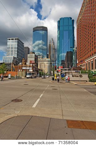 Pedestrain And Car Traffic And A Partial Skyline Of Minneapolis, Minnesota Vertical