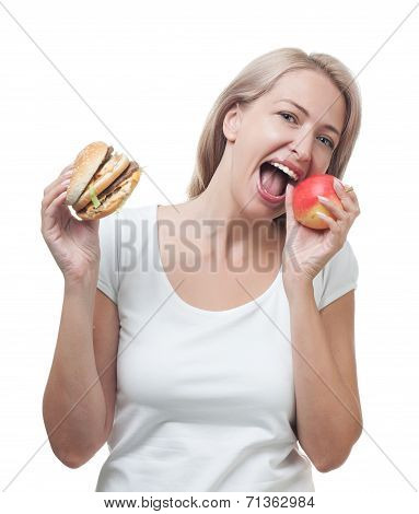 Girl Chooses Apple Not A Burger Isolated On White Background