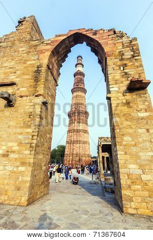 Tourists Walk Around Qutub Minar