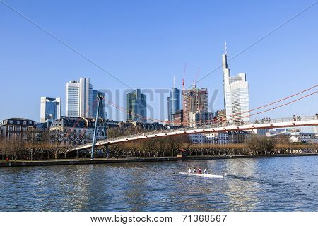 Holbein Bridge In Frankfurt Am Main With Skyline.
