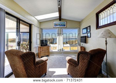 Sun Room Interior With Exit To Walkout Deck