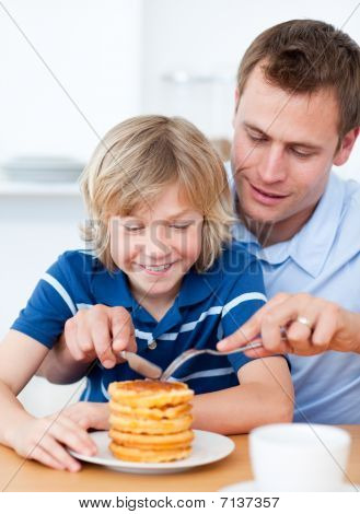 Attentive Father And His Son Eating Waffles