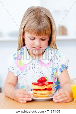 Adorable Little Girl Eating Waffles With Strawberries