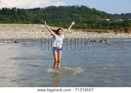 Young Woman In Mountain River