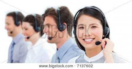 Portrait Of Smiling Customer Service Agents Working In A Call Center