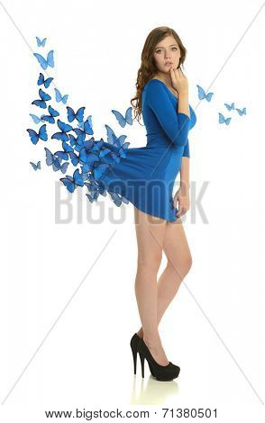 Young woman wearing a blue dress with butterflies isolated on a white background