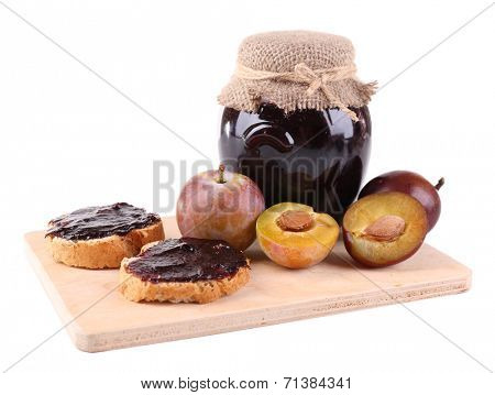 Plum jam, slices of bread with plum jam and fresh plums on cutting board isolated on white